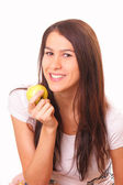 Beautiful woman with an apple — Stock Photo