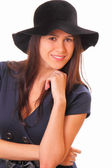 Beautiful young woman with a black hat — Stock Photo
