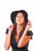 Pretty woman in a black hat — Stockfoto