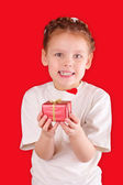 Little girl with a gift for Valentine's Day — Stock Photo