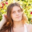 Attractive young woman in the open air — Stock Photo #27657405