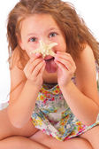 Funny little girl with starfish — Stock Photo