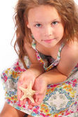 Pretty little girl with starfish — Stock Photo