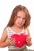 Beautiful little girl with a gift for St. Valentine's Day — Stock Photo