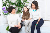 Cute little girl, her mother and grandmother together on this portrait — Stock Photo