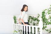 Beautiful girl on the terrace — Stockfoto