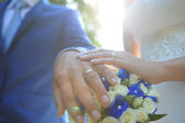 Wedding Ring and wedding bouquet — Stock Photo