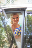 Beautiful bride in car — Foto Stock