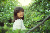 Portrait of young woman in the garden — Stock Photo