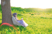 Reading a book in Nature — Stock Photo