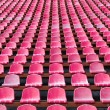 Stock Photo: Red seats for spectators in stadium