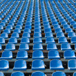 Stock Photo: Blue seats for spectators in stadium