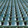 Stock Photo: Green seats for spectators in stadium