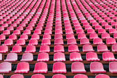 Red seats for spectators in the stadium — Stock Photo