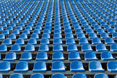 Blue seats for spectators in the stadium — Stock Photo