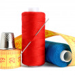 Spools of thread, needle, measuring tape and thimble isolated on white back — Stock Photo