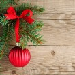 Spruce branches with christmas decoration on wooden background — Stock Photo