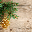 Golden pine cone on christmas tree — Stock Photo #13745915