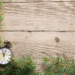 Stock Photo: Christmas tree and antique watch on wooden background