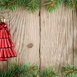 Christmas decoration and christmas tree branches on wooden background — Stock Photo