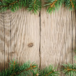 Stock Photo: Branches of christmas tree on wooden background