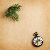 Retro christmas background with antique watch and branch of christmas tree — Stock Photo