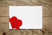Valentine card with red heart and ribbon — Stock Photo