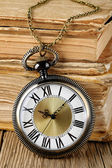 Antique watch and books — Stock Photo