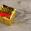 Stock Photo: Valentine gift box with two hearts on wooden background
