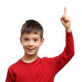 Happy child with good idea holds finger up isolated on white background — Stock Photo