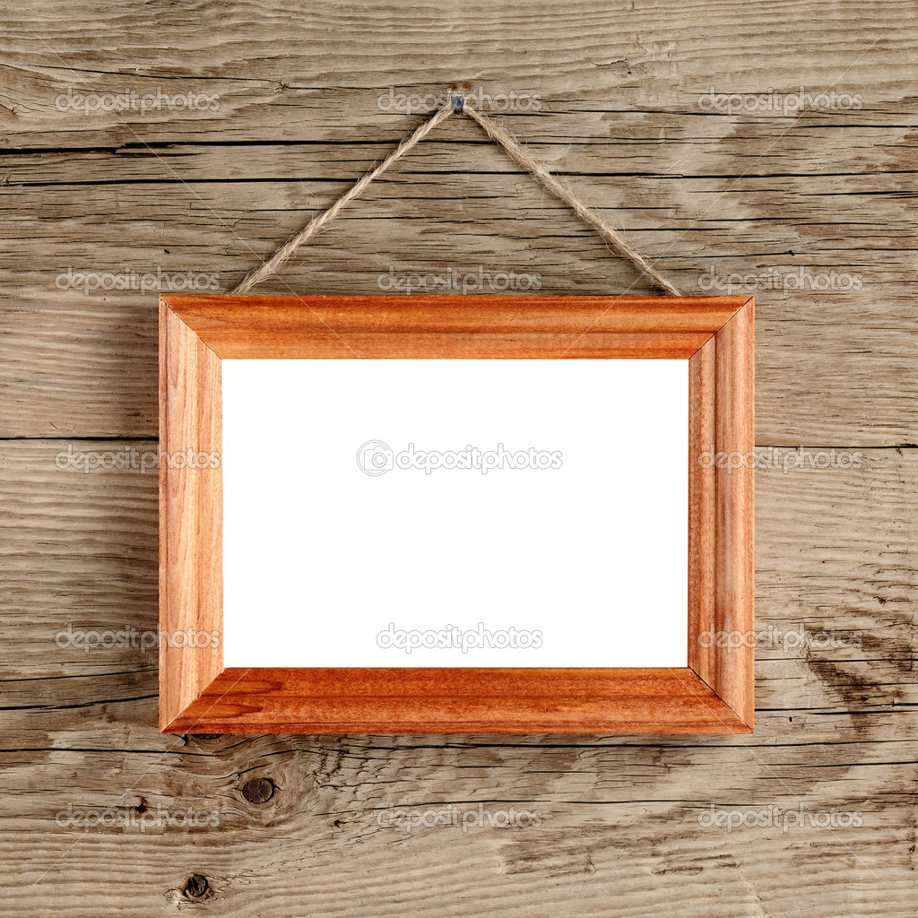 Photo Frame Hanging On Old Wooden Wall Stock Photo