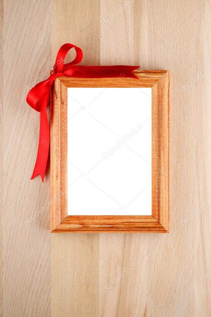 Cornice con fiocco rosso su legno foto stock 21687687 for Cornice foto legno