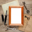 Old photo frame on wooden background — Stock Photo #22828560