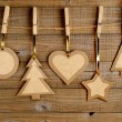 Old paper christmas decorations on wooden background — Stock Photo #33172735