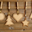 Old paper christmas decorations on wooden background — Stock Photo