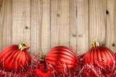 Red christmas balls on wooden background — Stock Photo