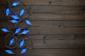 Blue christmas lights on wooden background — Stock Photo