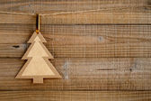 Paper christmas tree on wooden background — Stock Photo
