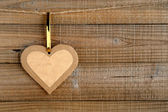 Paper heart on wooden background — Stock Photo