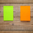 Two post-it notes on wooden background — Stock Photo