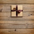 Stock Photo: Gift box with bow on wooden background