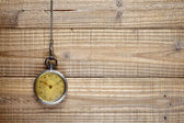 Antique pocket watch on wooden background — Stock Photo