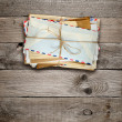 Bunch of old envelopes on wooden background — Stock Photo #51532027