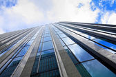Skyscaper and blue sky, wide angle — Stock Photo
