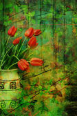 Grunge, Spring background with red tulips — Stock Photo