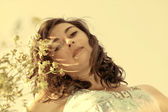 Beautiful, young woman among wildflowers — Stock Photo
