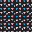 Pink and blue hearts on black seamless vector — Stock Vector