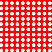 White polka dots on red seamless — Stockvector