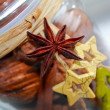 Christmas decoration, walnuts in a glass jar — Stock Photo