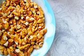 Christmas preparation, walnuts in a bowl — Stock Photo